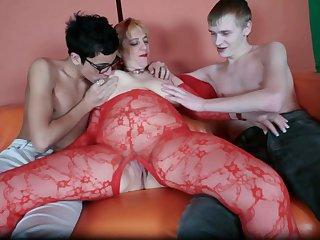 Cute young boys with big horny hoses are double penetrating this fat slut through the hole in her bodystocking
