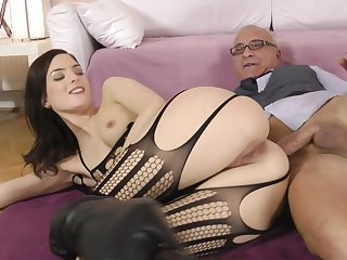 Brunette in sexy stockings is having nasty sex with this nice horny grandpa on sofa