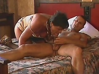 Horny as hell mature Karen is giving a blowjob for that young fucker in the bedroom