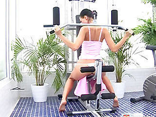 Pony-tailed teen brunette trains at the gym before masturbating warmly on the floor
