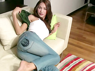 Beautiful ladyboy getting naked to tempt us and seduce us