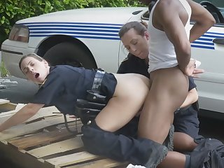 Slutty cops abusing naughty black stud outdoors