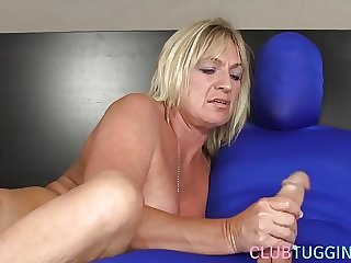 Busty mature jerking her subject