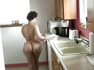 BLACK GIRL CLEANING KITCHEN