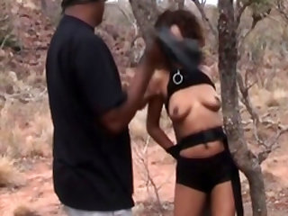 Bondage and rough outdoor spanking with an African slut