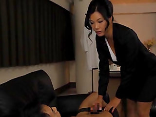 Katase Hitomi is a business woman and she jerks a guy off in her hand
