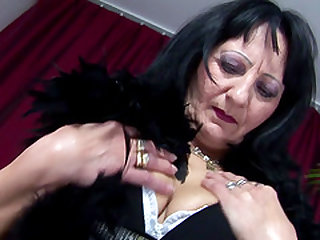 Cute granny Marita drilling her anal using long toy