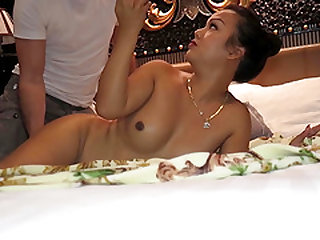 A guy gives a massage to Thai tranny Amy and gets his dick sucked in return.