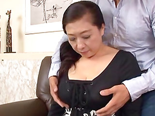 Mature Japanese chick spreads her legs for a man's touch
