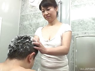 Curvy Asian washes his hair and sucks cock in the bathroom