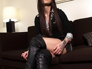 Tranny in black leather boots is a smoking hot treat
