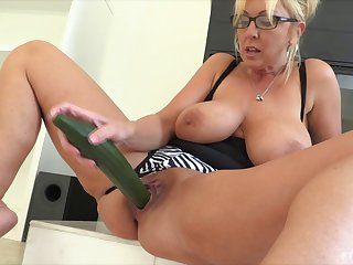 Using veggies to fuck her holes leaves her gaping wide