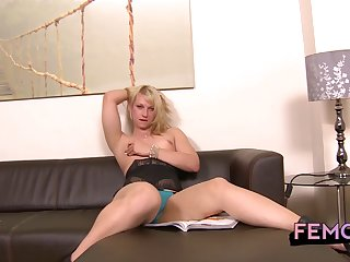 Pretty blue eyes on the sexy solo stroking tranny blonde