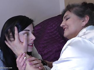 Mature lesbian uses her magic tongue to make a teen hottie cum