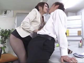 Gorgeous pantyhose girl makes the boss feel good with her hands