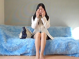 Amateur dark haired Japanese lady is a bit shy and needs to relax