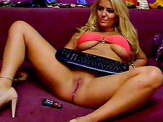 Naughty blonde girl with big boobs sticks remote onto her wet pussy