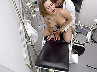 Melany Kiss lets a kinky doctor plow her shaved pussy hole