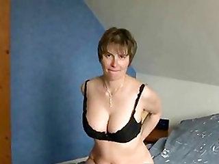 Short haired mature slut rubs her nipples and finger her nasty huge cunt.