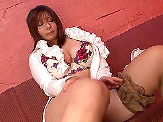 Bosomy Japanese milf fingering her cock-craving private part