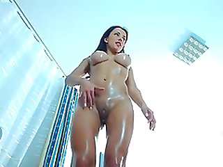 Sexy oily wet babe in bathroom shows off her tight wet pussy and ass while on cam