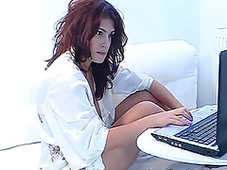 Hot redhead babe with big tits stripteasing and fingering her pussy on webcam