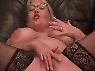 Plump blonde with big breasts playing with her very excited pussy
