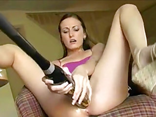 Baseball bat fucks her pussy on the couch