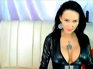 Pretty babe in leather strips to show her big boobs and dildo her tight pussy.