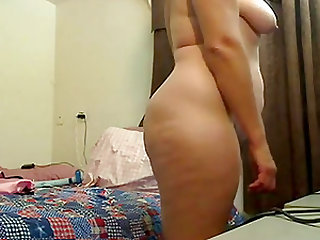 Mature really enjoys toying her big fat pussy