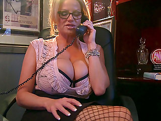Kelly Madison masturbates while talking on a phone