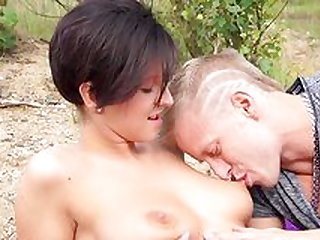 Busty young brunette gets a lot of dick by the lake