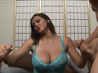 Sara strokes two guys off onto her big, natural tits