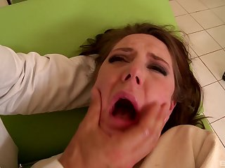 The doctor shoves his cock down her throat and makes her gag