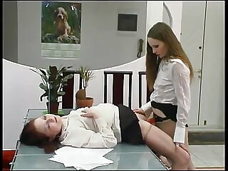 Two lesbians in office fuck each other with a strap-on