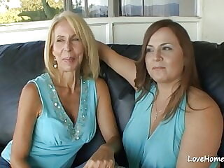 Two gorgeous lesbian chicks are masturbating together