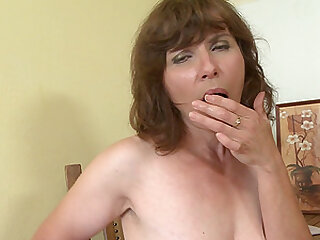 Beautiful babe Marisah licks her hard nipples while she masturbates