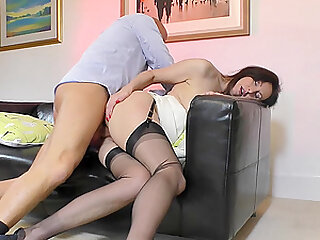 MILF in stockings gives a handjob and rides a big hard cock