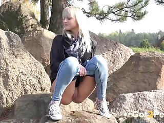 Blonde filmed taking a piss on a rock
