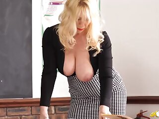 Teacher in a tight blouse has sexy cleavage