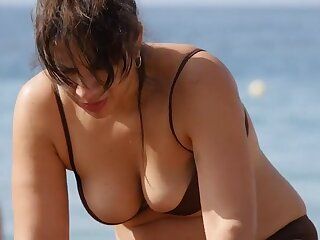 Spy on her sexy big tits on a beach day