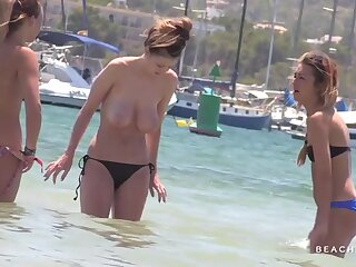 Voyeur films coeds at a topless beach