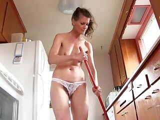Sexy old lady cleaning house in her bra and panties