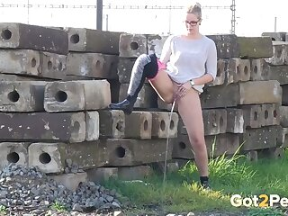 Sweater and tights on chick pissing outdoors