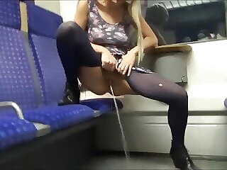 Teen blonde pissing in the train