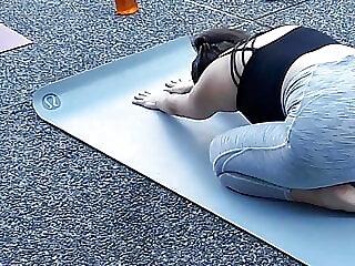 Gray yoga pants doing yoga