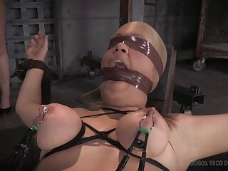 Blindfolded girls are bound and suffering in the dungeon