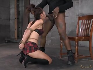Tied submissive sucks black cock from her knees