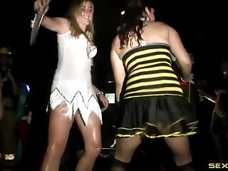 Slutty costumes on hot ladies dancing at a party