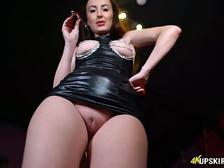 Bootyful chick in leather dress shows off her plump pussy upskirt